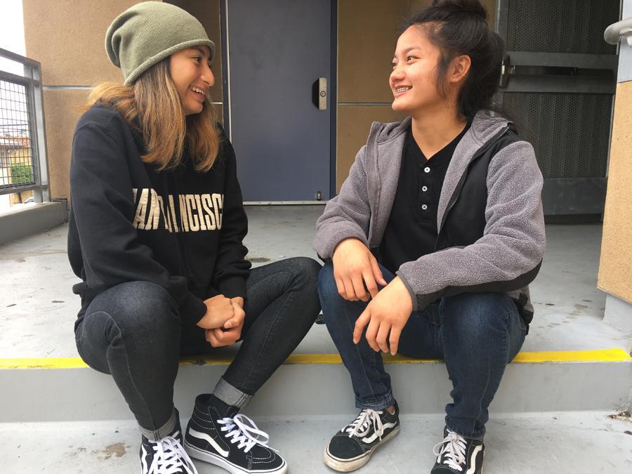Seniors Annika Kheav and Jessica Ong mock a loving pose.