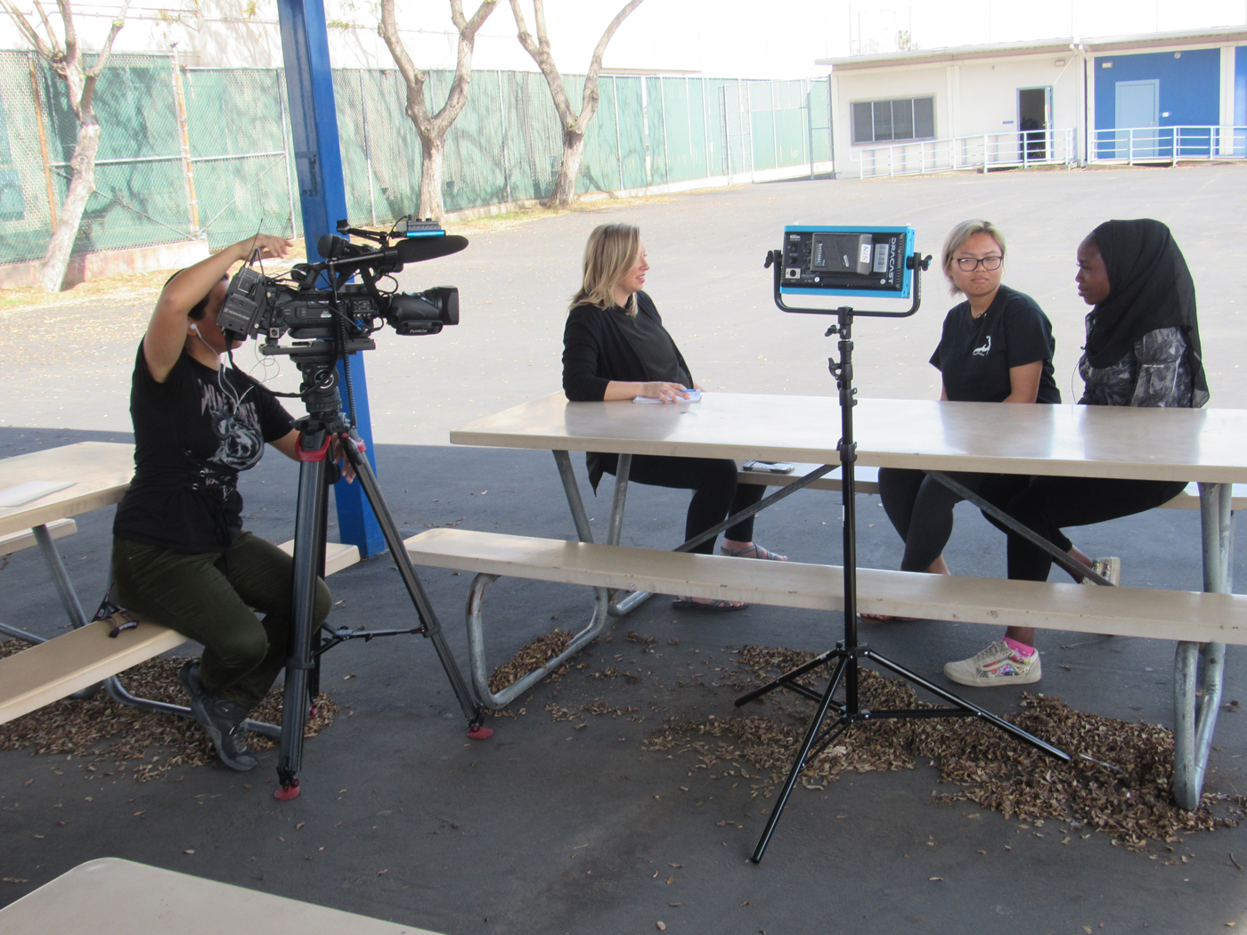 KPBS reporter Tarryn Mento interviews Makayla Siharath and Machair Adam about the upcoming Hoover Peace Conference Against Gun Violence symposium scheduled for April 20.